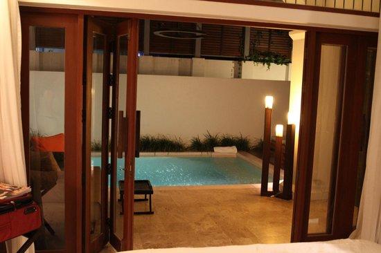 SALA Samui Resort And Spa: View of the villa pool lighted up.