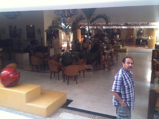 Marina Fiesta Resort & Spa: open-air lobby....(my husband at right)