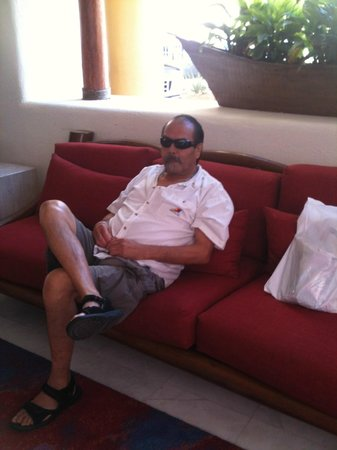 Marina Fiesta Resort & Spa: My husband relaxing in lobby....(where I would come for FREE Internet reception)
