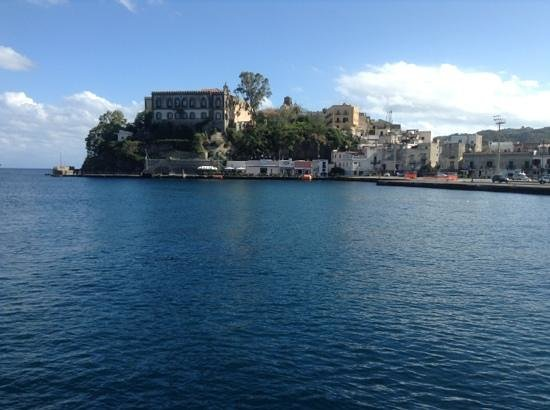 looking across the harbor towards La Conchiglia situated below the city hall and St. Barthlomew'