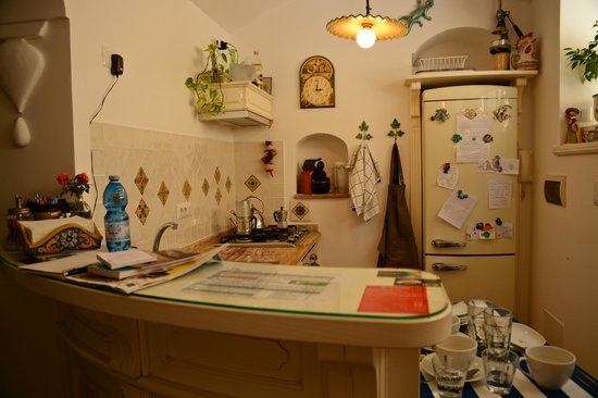 "Dimora del Podesta: ""Honesty Bar"" in the common area: the hosts trust the guests to take note of the items they took"