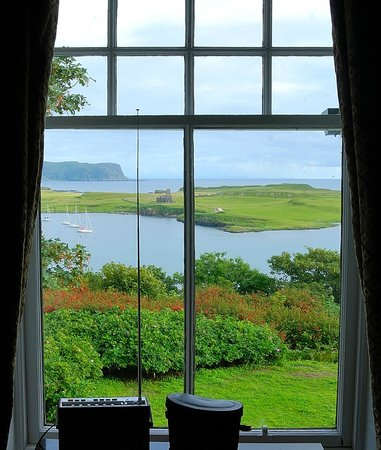 Tighard Guest House: View from the Goroghon Room of St Edward's Chapel on Sanday, and Rum beyond.