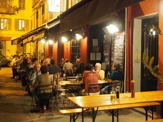 Le Local, to escape the smokers, sit indoors, but away from the front door.
