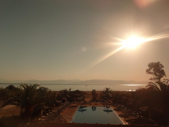 Sunrise Apartments : Paradise!   View from our 2nd floor room 8am.  Sunglasses over camera lens to reduce the suns