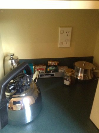 Birchwood Manor Motel: Cupboard containing Coffee, Tea, kettle, coffee plunger, tea pot