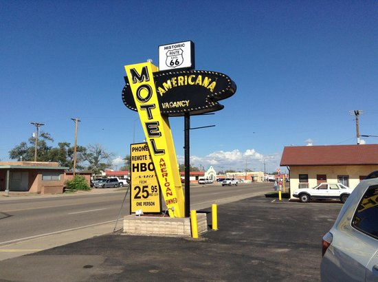 """Americana Motel : Don't be fooled by 'American Owned"""" on sign"""