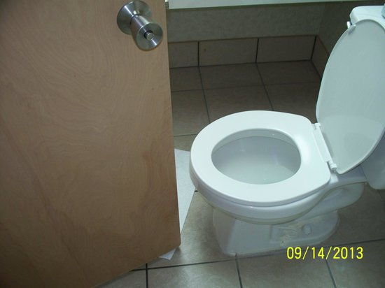 """Holiday Sands North: 3-4"""" between commode & door, """"Watch out for your knees"""""""