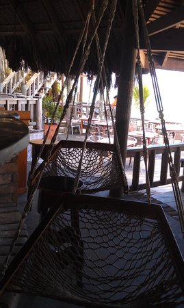 Kuyaba Hotel & Restaurant - Negril: Swing chairs at the bar.