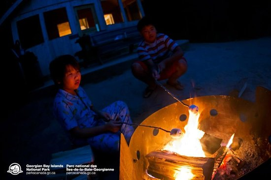 Georgian Bay Islands National Park Of Canada Roasting Marshmallows Over The Campfire At One