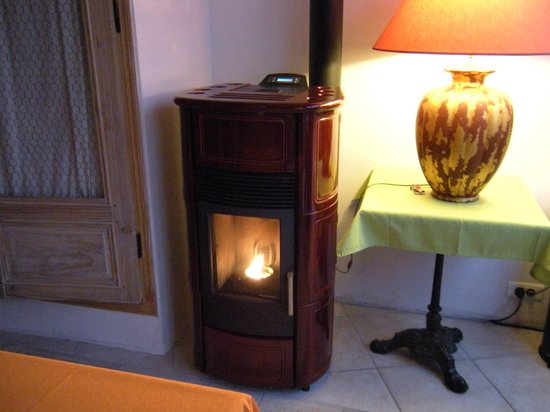 La Grange: The ceramic, pellet burning stove in the dining area