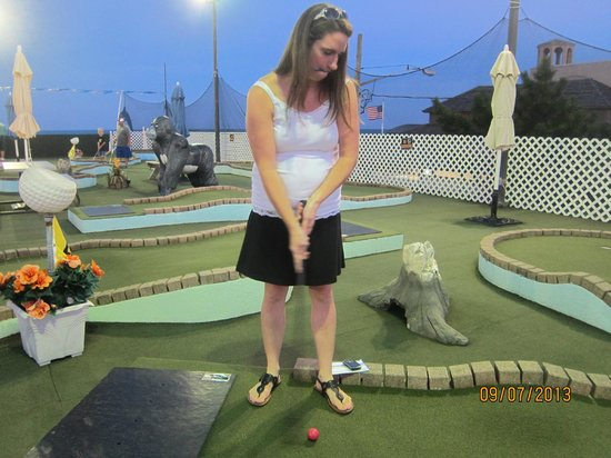 Ryan's Mini Golf: my wife making a shot