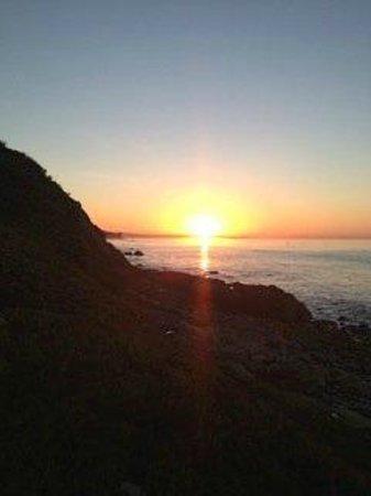 SUNRISE AT NICHOLAS CANYON BEACH