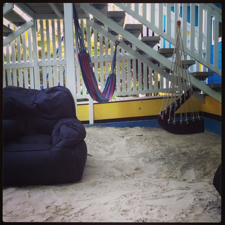 "Coral Inn Yeppoon: ""Sandpit"" area with relaxing chairs, hammocks, etc. to relax in. Near the pool, but not beside i"