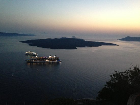 Homeric Poems: Cruise ships light the sea in the middle of the caldera.