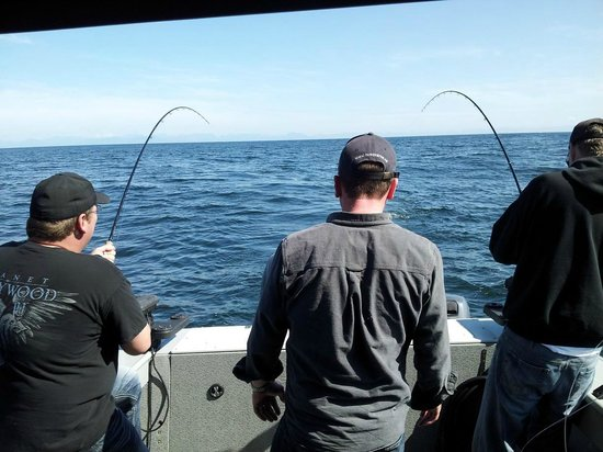 Salty Dog Fishing Charters: Justin watching over both the neebies. lol