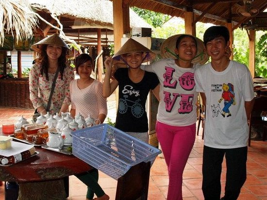 Mekong River Cruise-Day Tours: Worker at the coconut candy farm! Really cheerful!