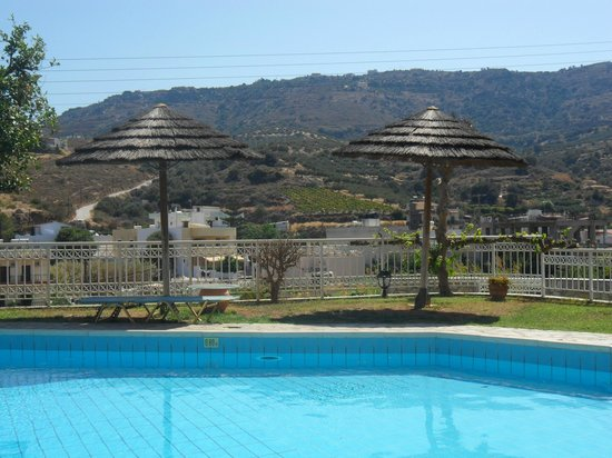 Aquarius Apartments: View by pool whilst sunbathing on the sun loungers