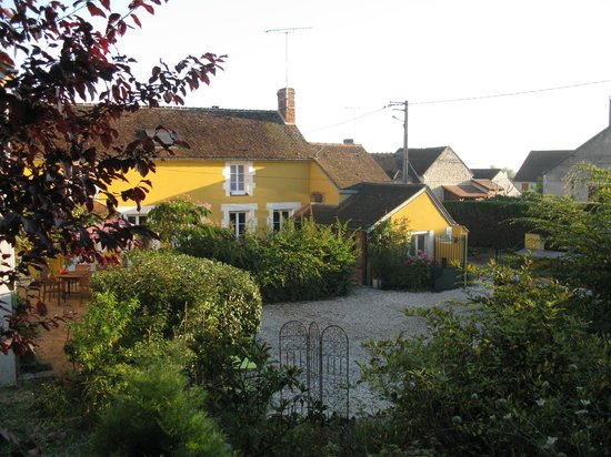 """A La Maison Jaune : The """"Yellow House"""" and parking area"""