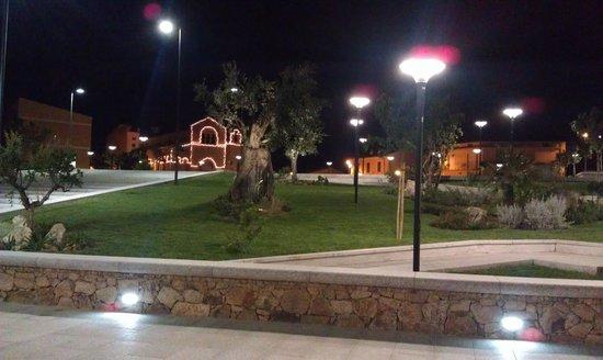 La Basilica di San Simplicio, vista di sera dalla piazza di recente costruzione Urban Center