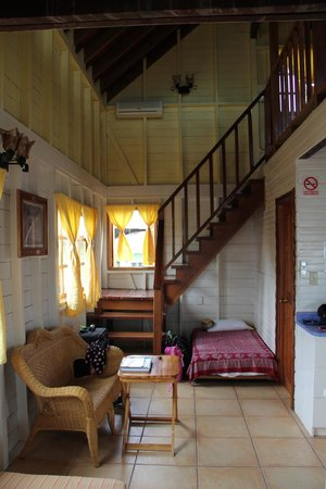 Koko Resort : Living area with sleeping cot tucked under the stairs