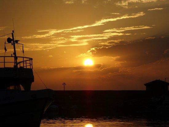Nakellis: SUNSET OVER MOLYVOS.