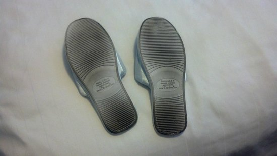 Cayo grande Suites Hotel: Bottom of house slippers after walking on the carpet for three days.