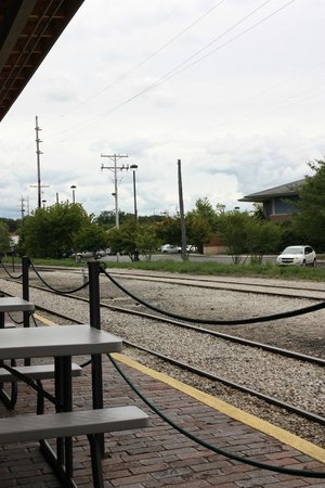 The Filling Station : Picnic tables by the rails on a historic train depot platform, nice!