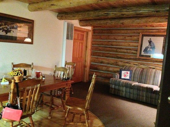 Luton's Teton Cabins : Living/dining area surrounding by cozy logs.