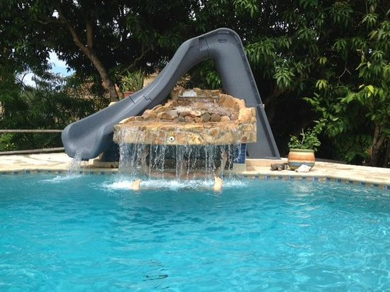 Caribbean Shores Bed & Breakfast: pool with water slide and waterfall