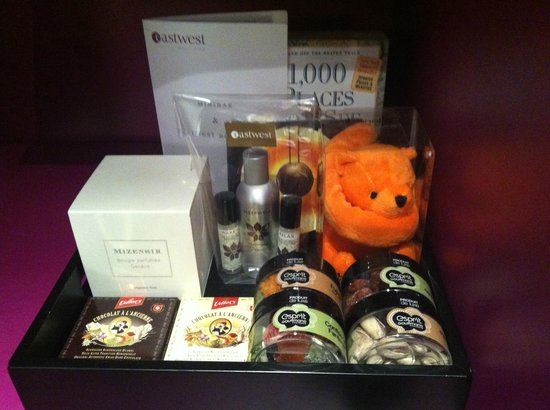 Eastwest Hotel: Part of the minibar - candle, snacks and aromatherapy for sleeping