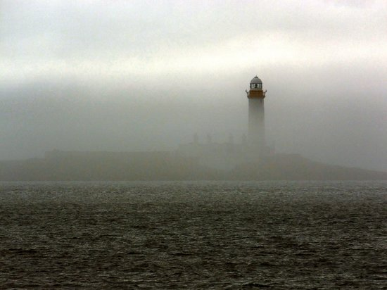 Duart Castle : Lismore Lighthouse in the mist