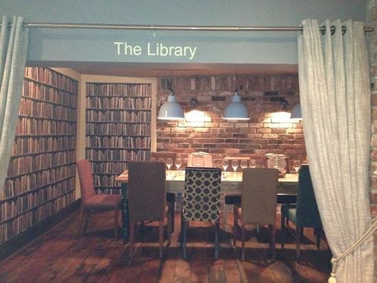 Swan Inn: the lovely library area. quirky wallpaper and amazing chairs. :)