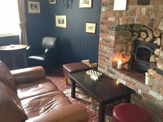 Swan Inn: the Snug- cosy area- cant wait for the fire to be roaring :)