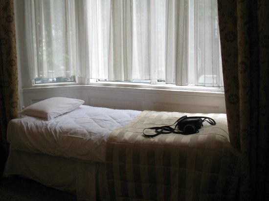 Kilronan House : Twin bed in family room near window.