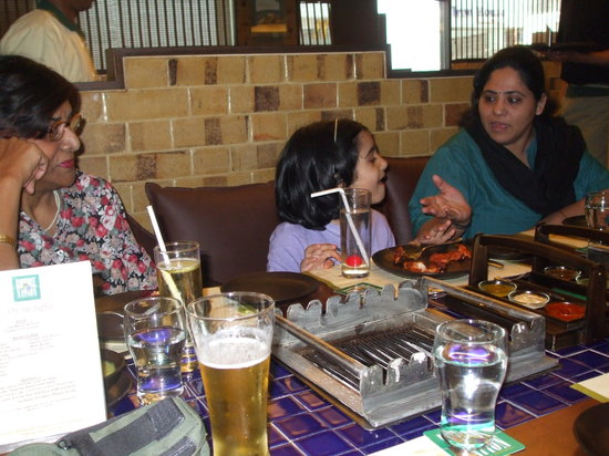 Barbeque Nation: Complimentary beer with meal and barbecue warmers on table