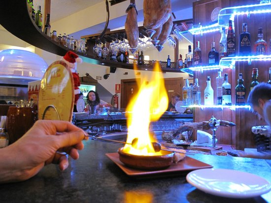 Redondo Bar: Chorizo roasting on an open fire... Merry Christmas from Nerja