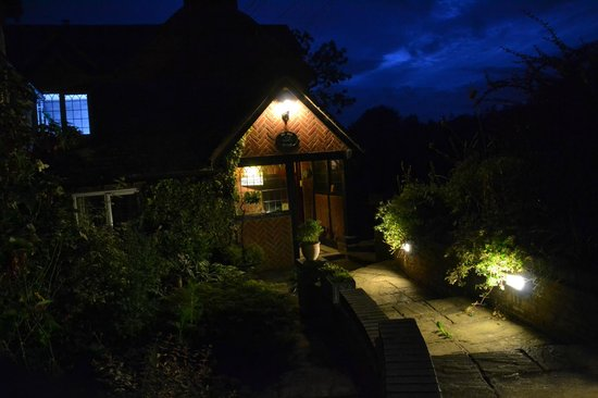 The Hill Cottage: Entrance way lit up at night