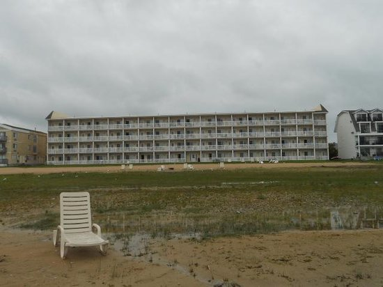 Mackinaw Beach and Bay - Inn & Suites: Inn from standing in Lake Huron