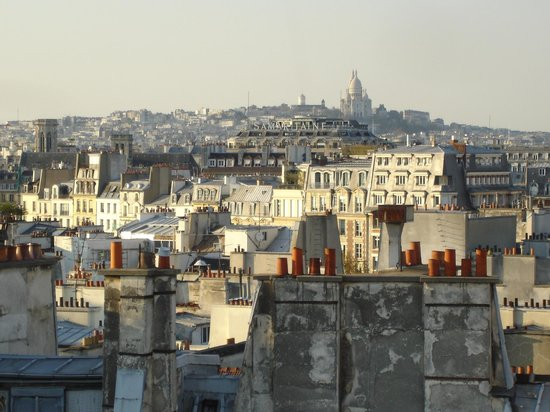 Holiday Inn Paris - Notre Dame: View over Paris from the roof of the hotel. Sacre Cœur in the background.