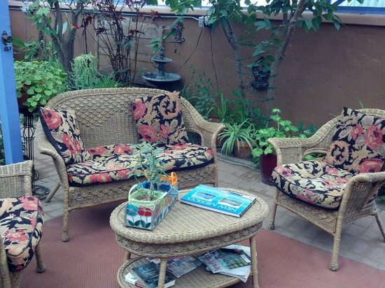Josefina's Old Gate: Greenhouse patio sitting area