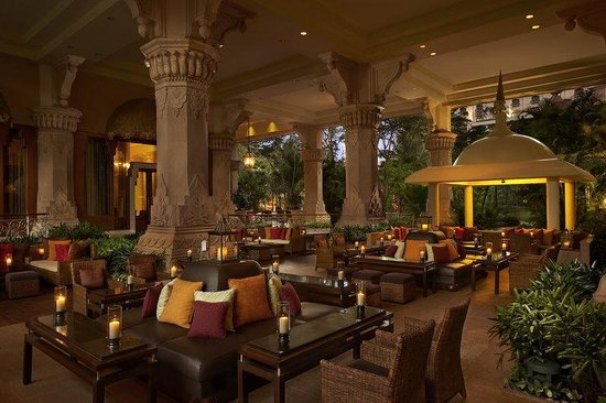 The Leela Palace Bengaluru: Outside seating area of the Library Bar