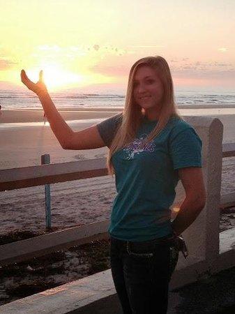 """Holiday Inn Resort Daytona Beach Oceanfront: Daughter """"Holding"""" The Sun outside of the hotel"""
