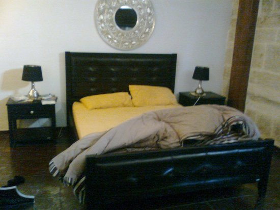 Luciano Valletta Boutique Accommodation: bed, view from the room entrance