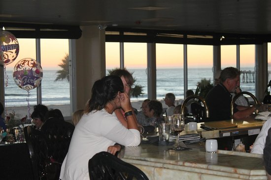 SeaVenture Beach Hotel: The sundown view through the restaurant. Great food, great times, great people. This place ROCKS