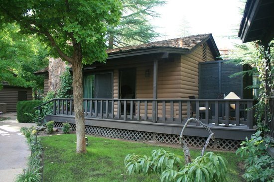 L'Auberge de Sedona: Cottage with porch and sliding door next to front door.