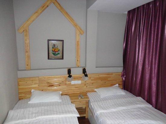 Tu'niu Youth Hostel Zhangjiajie Wulingyuan Biaozhimen: the bedroom