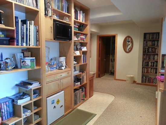 A Lakeside Bed and Breakfast: Bookshelves and refrigerator. Bathroom on left.