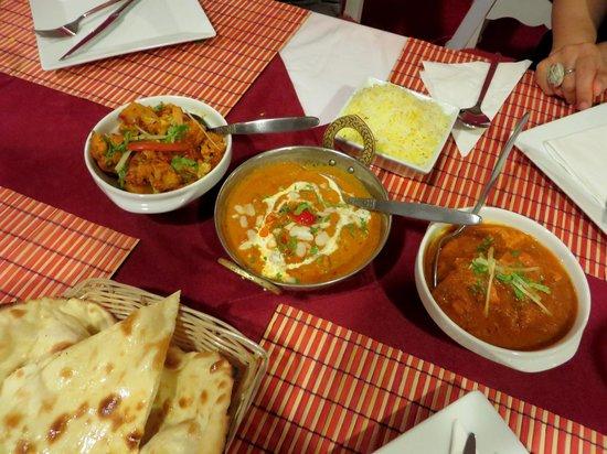 aloo gobi, saffron lamb curry, chicken vindaloo, & naan bread