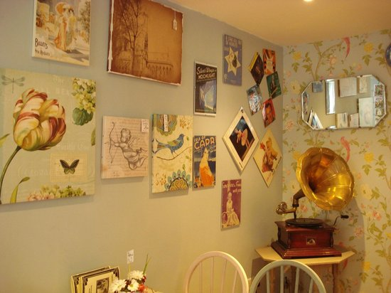 Biddys' Tearooms: Music sheets and pictures on the walls with Gramophone in the corner