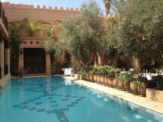 La Maison Arabe pool and dining